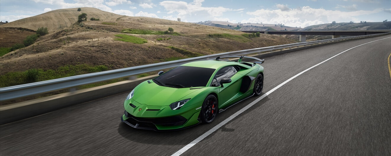 Aventador SVJ, matte green, 3/4 front view, driving on a street. Vegetation in background.